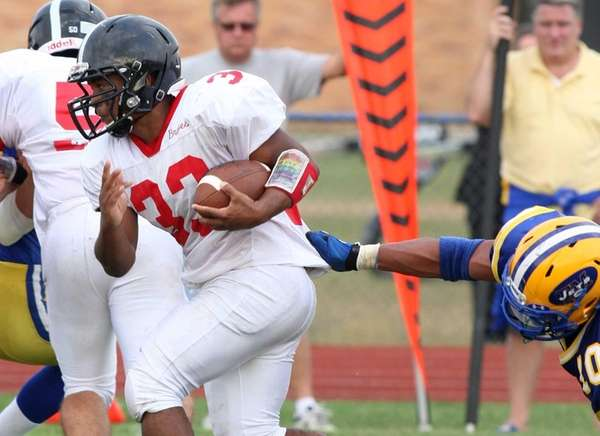 Syosset running back Brandon Nieves tries to break