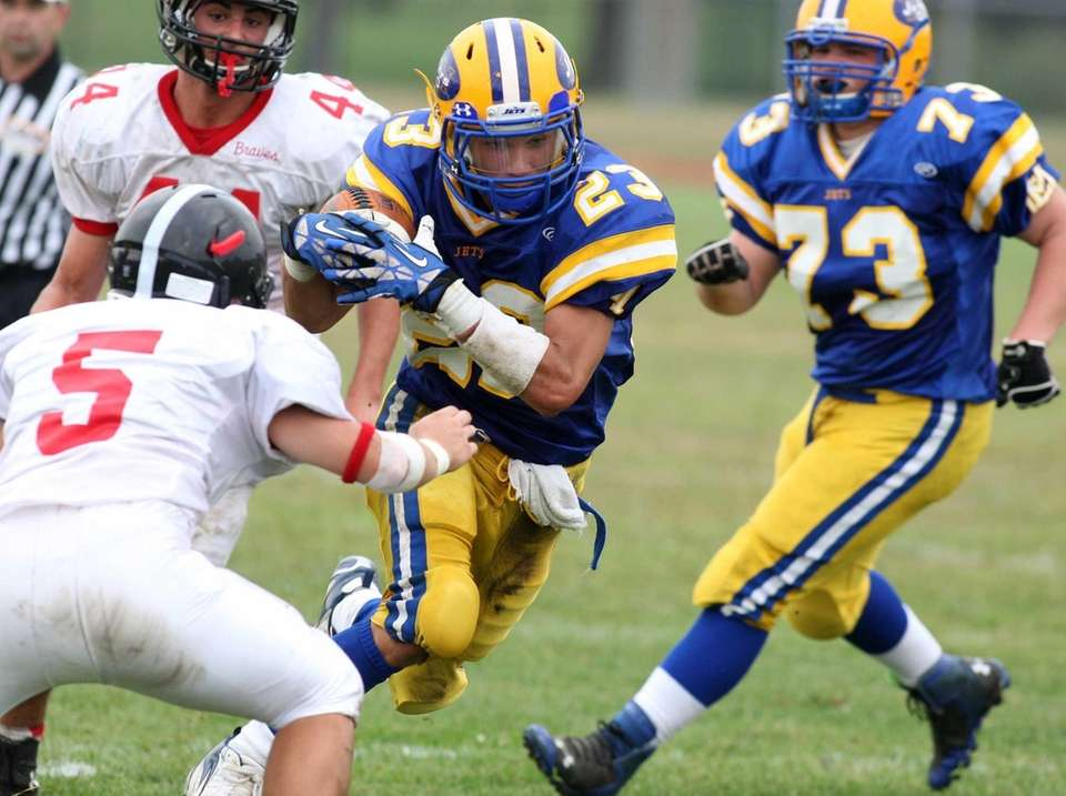 East Meadow's Nick Conti runs for some yardage