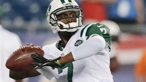 Geno Smith throws a pass as he warms