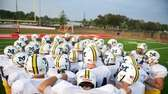 Massapequa players huddle before a game against Freeport.