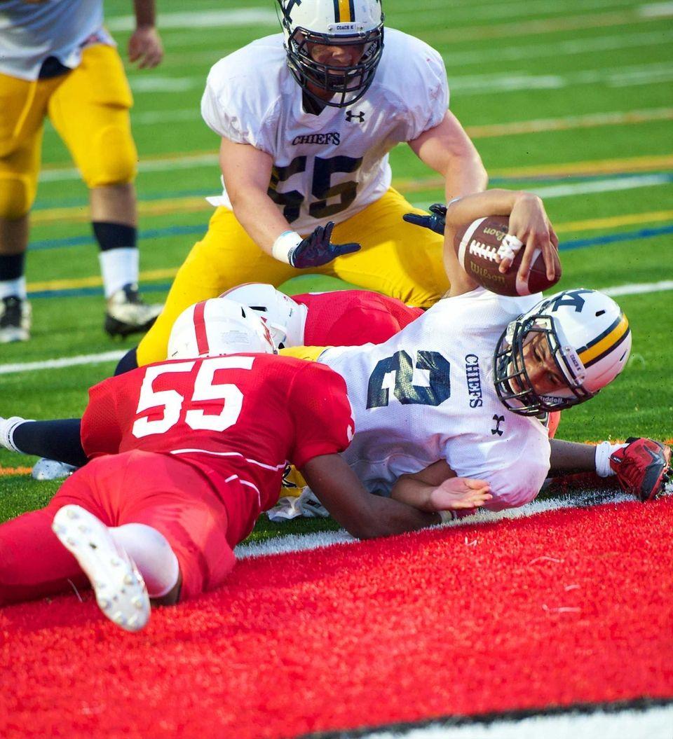 Massapequa quarterback Matthew Caracappa dives across the goal