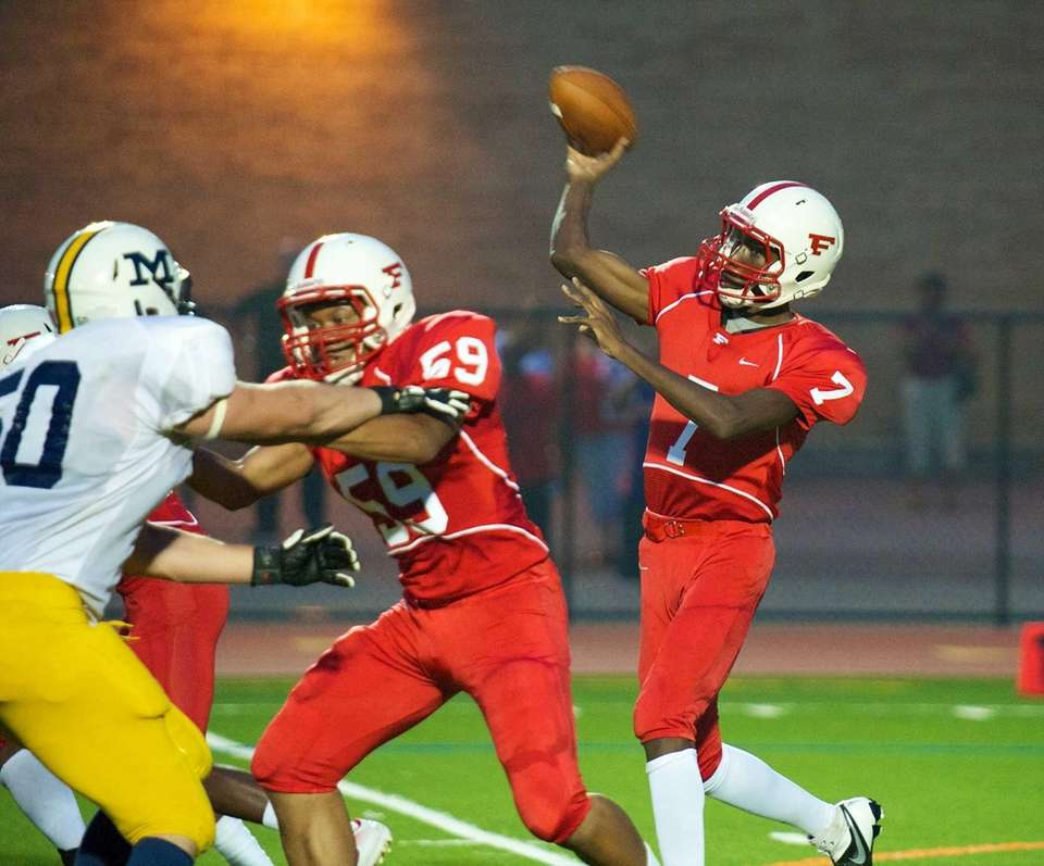 Freeport quarterback Davelle Hooks attempts a pass in