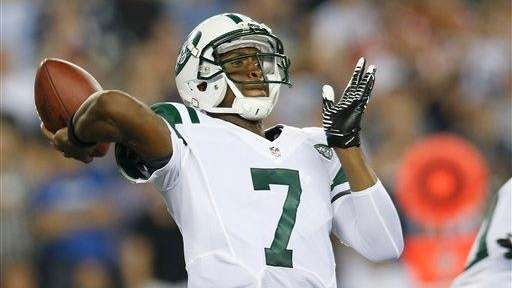 Geno Smith (7) passes against the New England