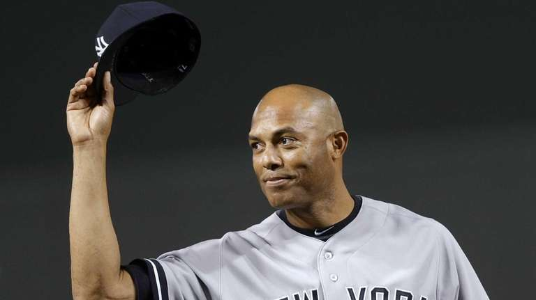 Yankees relief pitcher Mariano Rivera acknowledges fans during