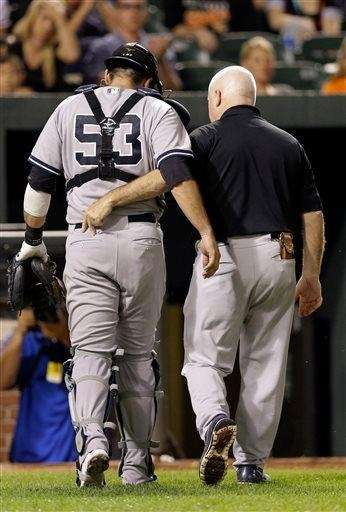 Austin Romine, left, walks off the field with