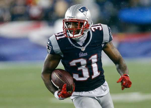 Aqib Talib of the New England Patriots runs