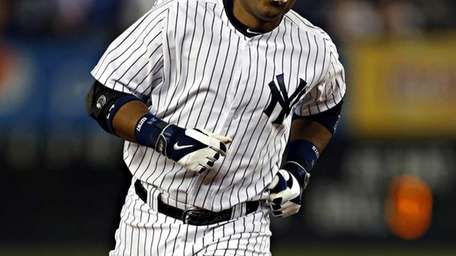 Robinson Cano rounds the bases after hitting a