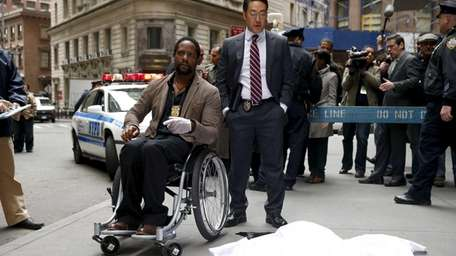From left, Blair Underwood as Robert Ironside and