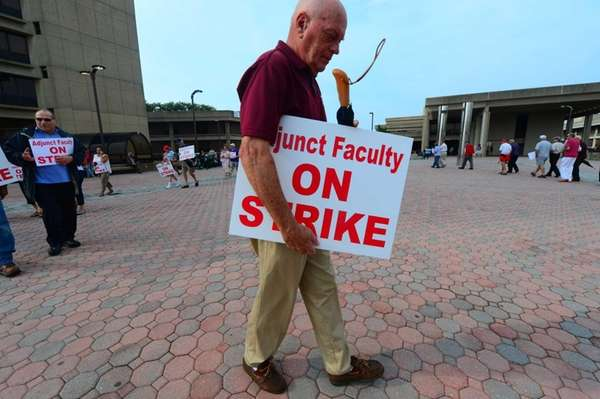 Adjunct Faculty Association members, on strike, picket outside