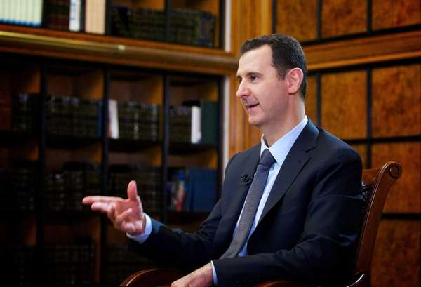 President Bashar al-Assad attends an interview with Russian