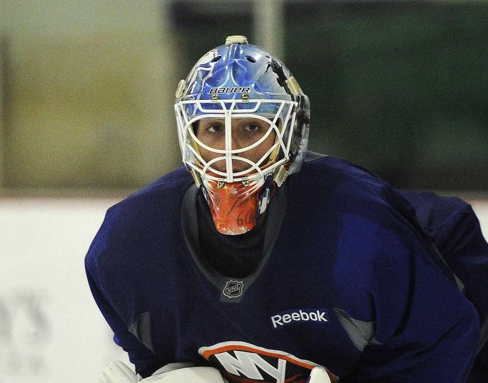 Islanders goalie Kevin Poulin protects the net during