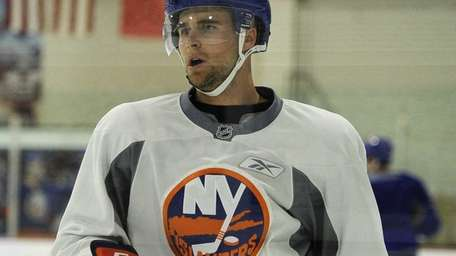 Islanders center Pierre-Marc Bouchard skates during training camp