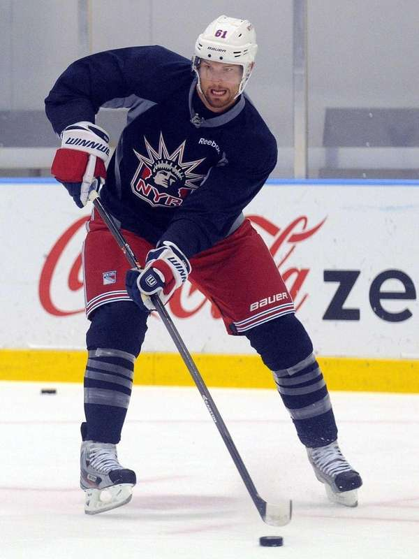 Rangers left wing No. 61 Rick Nash skates