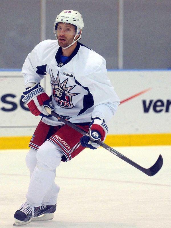 Rangers' Dominic Moore skates during team training camp