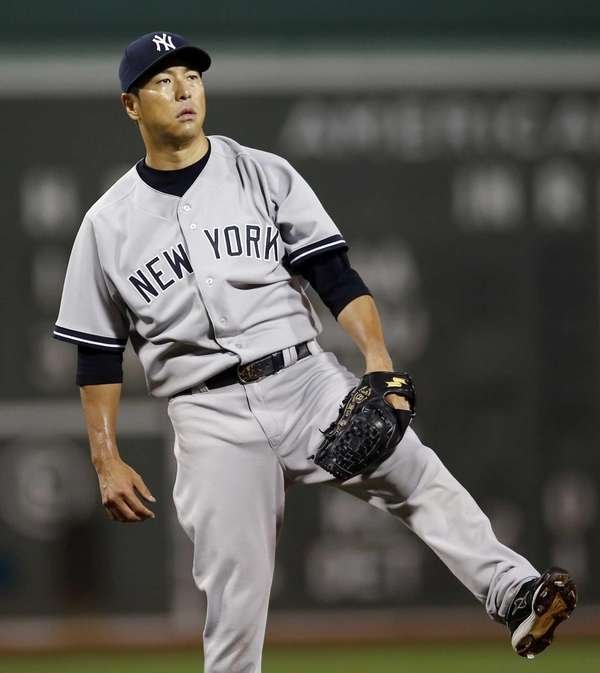 Yankees starting pitcher Hiroki Kuroda kicks his foot