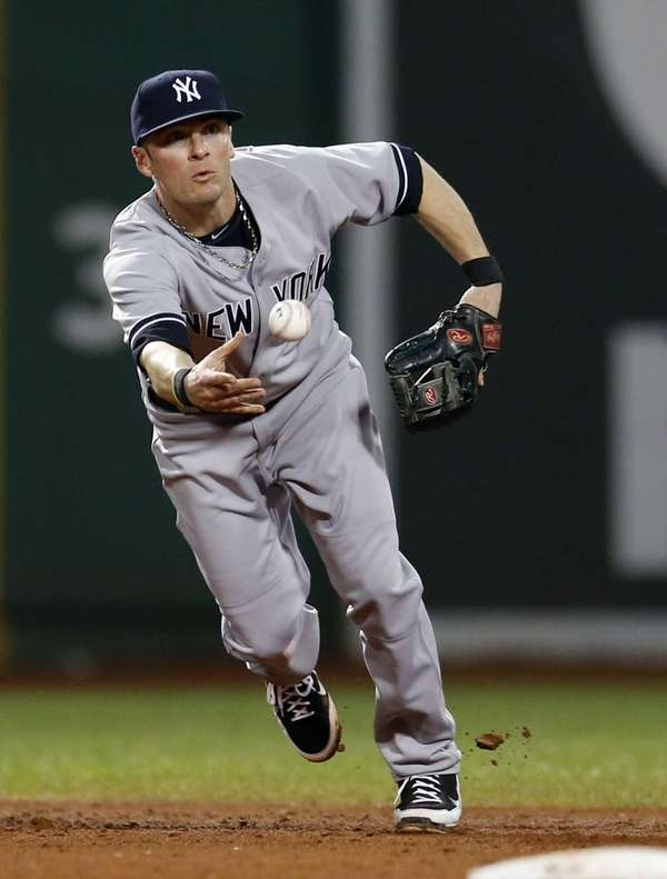 Yankees shortstop Brendan Ryan tosses the ball to