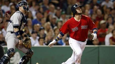 Boston Red Sox's Jarrod Saltalamacchia watches his grand