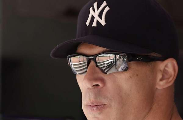 Yankees manager Joe Girardi looks on from the