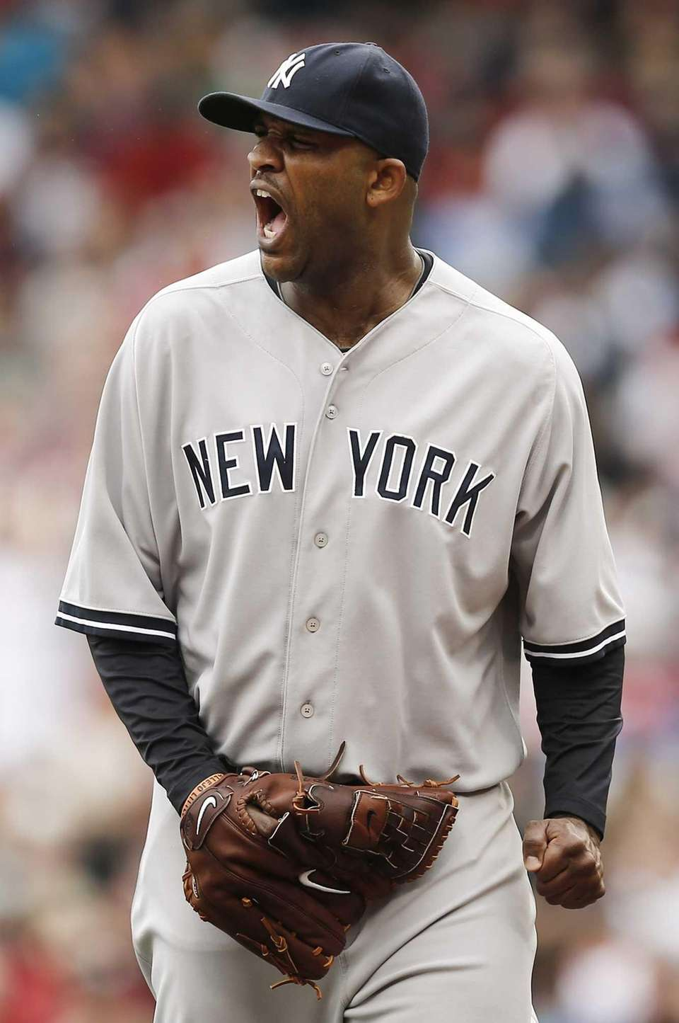 Yankees starting pitcher CC Sabathia shouts out while