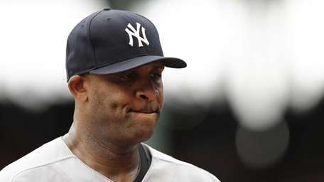 Yankees starting pitcher CC Sabathia bites his lip