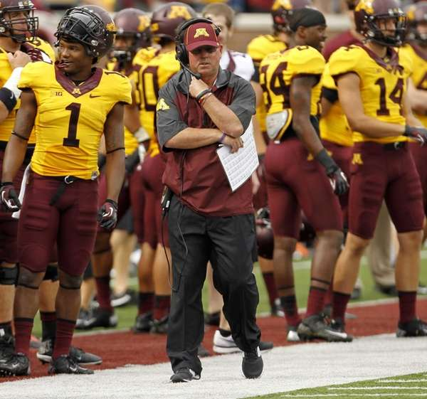 Minnesota head coach Jerry Kill walks the sidelines
