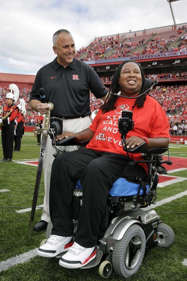 Rutgers head coach Kyle Flood, left, holds a