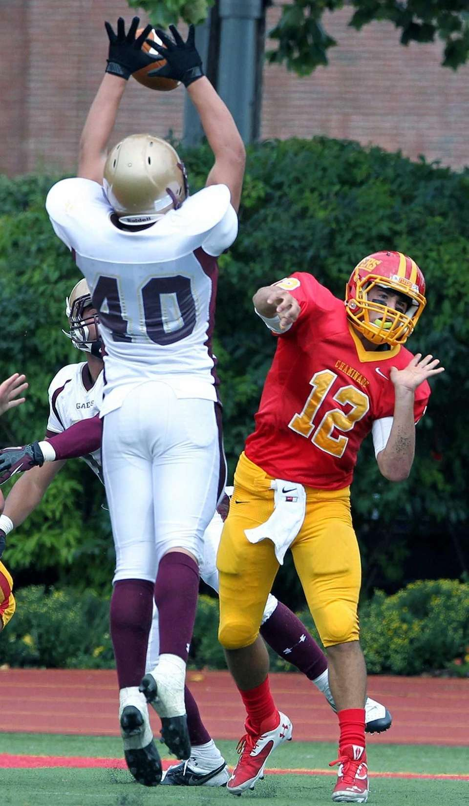 An Iona defender deflects a pass by Chaminade's