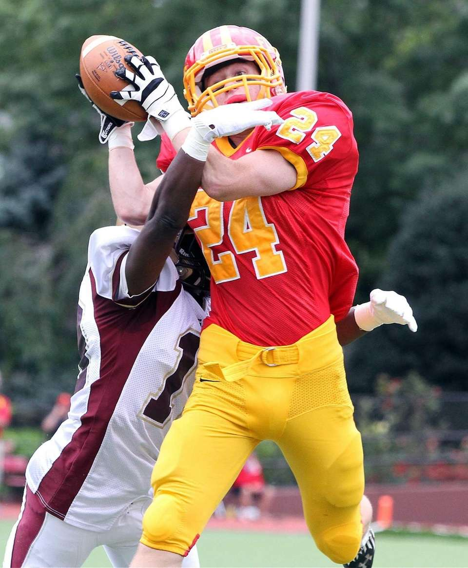 Chaminade's John Tigh makes an over-the-shoulder catch near