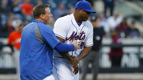 Frank Francisco of the Mets is led off