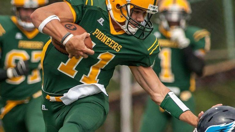 LIU Post's quarterback Steven Laurino goes airborne to