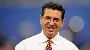 Washington Redskins owner Dan Snyder walks across the