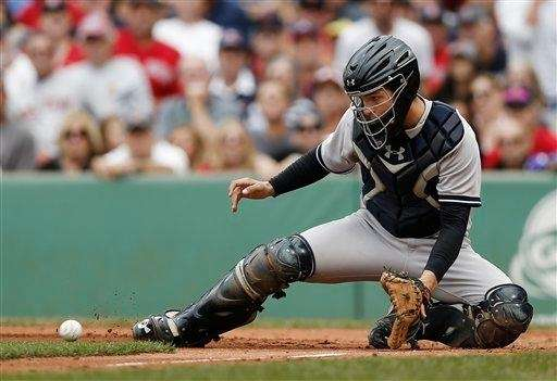 Yankees catcher J.R. Murphy waits for a throw