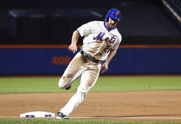 Mets runner Daniel Murphy rounds third base to