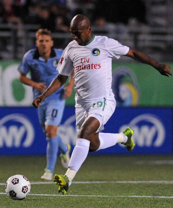 Cosmos midfielder Marcos Senna passes downfield in the