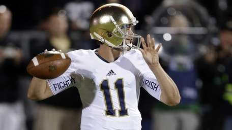 Notre Dame quarterback Tommy Rees throws against Purdue