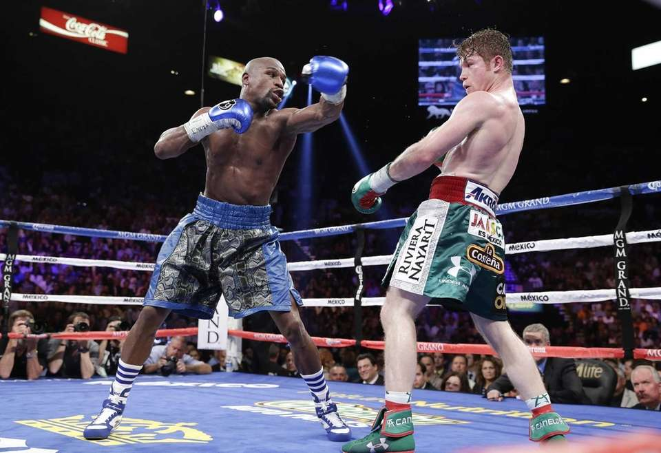 Floyd Mayweather Jr. throws a jab at Canelo