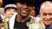Floyd Mayweather Jr. celebrates his majority decision victory