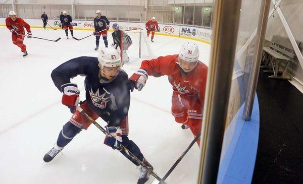 Rangers' Ryan McDonagh, left, and Jesper Fast chase