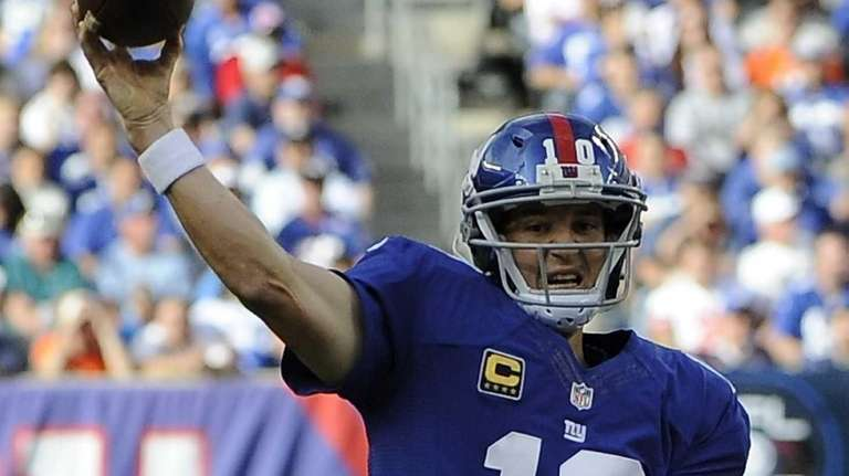 Eli Manning throws a pass during the first