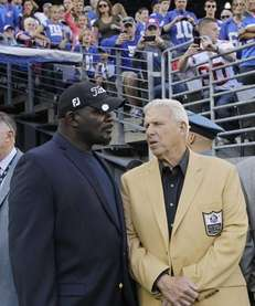 Lawrence Taylor, left, and Bill Parcells talk during
