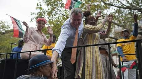 Democratic mayoral candidate Bill de Blasio is joined