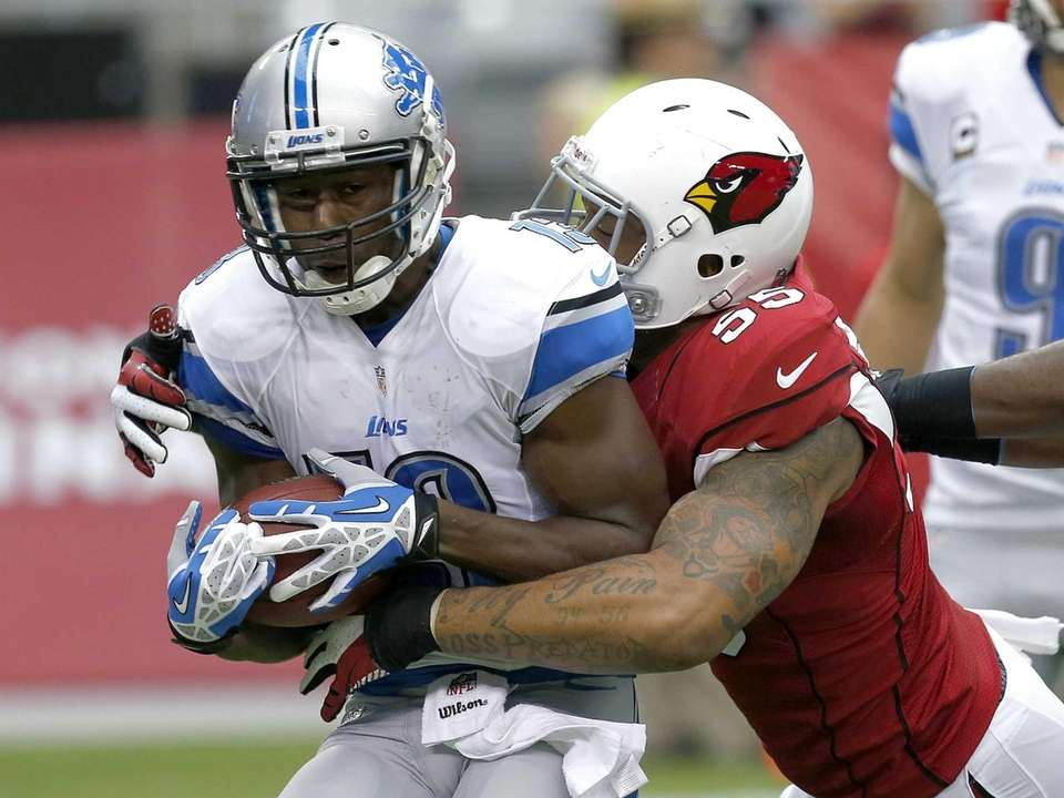 Detroit Lions wide receiver Nate Burleson is tackled