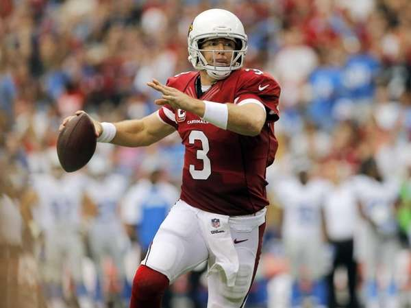 Arizona Cardinals quarterback Carson Palmer scrambles against the