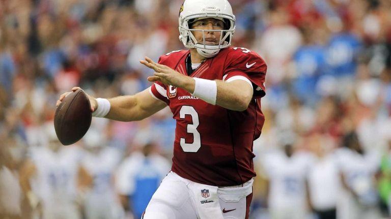Arizona Cardinals quarterback Carson Palmer scrambles against the