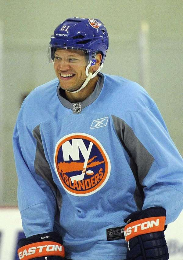 Islanders right wing Kyle Okposo reacts during training