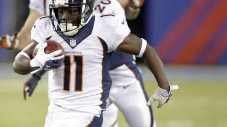Denver Broncos wide receiver Trindon Holliday runs away