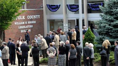Long lines form as people pay their respects
