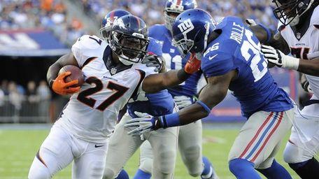 Denver Broncos running back Knowshon Moreno #27 rushes