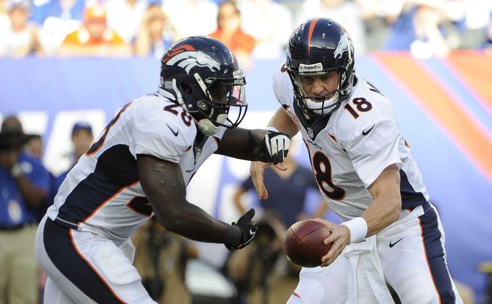Denver Broncos quarterback Peyton Manning #18 fakes a