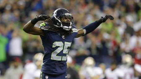The Seattle Seahawks' Richard Sherman celebrates after the